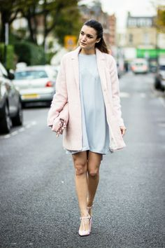 Anisa Sojka wearing light blue Peggy Haranto dress, pink Clic Jewels lunch bag with tassels, Topshop duster coat, and pink Zara pointed heels. Fashion blogger street style shot in London by Cristiana Malcica.