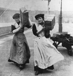 Porters: The number of women employed in the transport industry increased by 555 per cent during the war, and included this pair of female porters at Marylebone Station in 1915