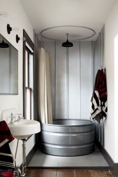 16 Creative Ways to Transform Your Home and Backyard with Stock Tanks During your next bathroom renovation, infuse some rustic flair into your bathroom by asking your contractor to install one of these beauties. See more at Stickett Inn. Cabin Bathrooms, Primitive Bathrooms, Small Cabin Bathroom, Small Rustic Bathrooms, Country Bathrooms, Rustic Cabin Bathroom, Bathtubs For Small Bathrooms, Small Bathtub, White Bathrooms