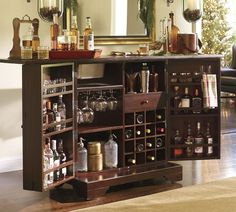 Modine Bar from Pottery Barn. Opens to over 7', and I had to have a large bedroom to accomodate this one. Plus there is a relaxing area near where I put a leather RL Safari Club Chair with metal studs.