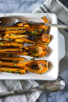 Savory roasted butternut squash with black garlic and miso paste...a delicious and easy fall side dish, this recipe is vegan and healthy!   www.feastingathome.com