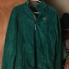 North face jacket In really good condition. Only worn several times, it's like a teal color, super soft. The North Face Jackets & Coats