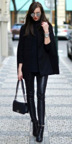 Barbora Ondrackova + black cape coat + black knit turtleneck sweater + leather leggings + studded black leather ankle boots + black quilted leather bag  Cape: Missguided, Turtleneck: Proenza Schouler, Leggings: Balenciaga, Boots: Givenchy, Bag: Chanel, Sunglasses: Dior, Watch: Michael Kors. Legging Outfits    #fashion, #fashionista, #fashionblogger, #streetstyle, #fashionicon, #instastyle, #instafashion