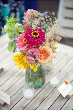 Mason Jar Flower Arrangements Weddings | Beautiful bold colored mason jar flower arrangement. Flowers from half ... Outdoor Table Decor, Outdoor Table Centerpieces, Summer Table Decorations, Colorful Centerpieces, Table Arrangements, Mason Jar Centerpieces, Wedding Centerpieces, Wedding Decorations, Vases