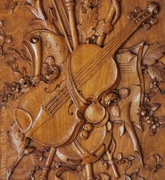 Carved trophy | Musical trophy carved in walnut | http://www.patrickdamiaens.be | High end architectural wood carving