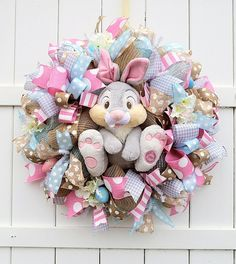 This Easter wreath is in stock and ready to be shipped! This Thumper wreath was designed to coordinate with my Miss Bunny wreath. They would look great together on a set of double doors! Heres link to the Miss Bunny wreath listing: