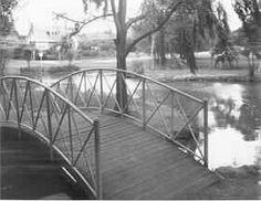 MP 7348. The bridge over the lake at Hedgeley Dene Gardens, East Malvern; c.1970.