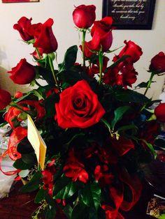 A dozen long stem red Love roses