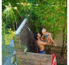 Not quite an indoor pool but love an outdoor sower. tropical patio Back deck and hot tub ideas