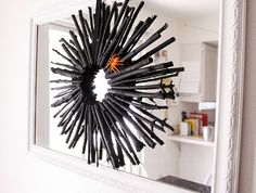 Spray paint some black twigs and glue them to a wreath form covered in black duct tape... magical! found at http://www.trendytree.com/blog/?p=3941