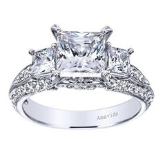 The three stone princess cut is an engagement ring that out does all others in terms of luxury. Like the best refined estate jewelry finds, it comes in 18 karat white gold and accompanied by flawless diamonds.