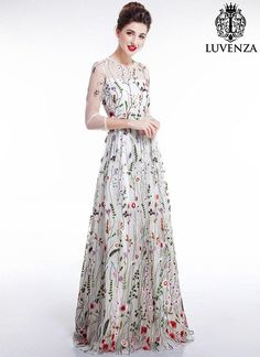 Some women enjoy the chic sophistication of deep, dark colors, but you prefer the playfulness and light of bright spring-inspired colors. This white floor length dress is an elegant nod to your colorful, playful spirit. Elegant, but whimsical floral embroidery flows up the dress from the