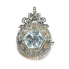 A Fabergé diamond, aquamarine and gold pendant/ brooch, Moscow, 1899-1908    the hexagonal-cut central stone within a circular openwork mount set with flowerheads, ribbon tie surmount, with KF, scratched inventory number 27742