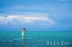 Stand up paddle surfing in Ambergris Caye, #Belize. A cool way to explore the #Caribbean Sea.