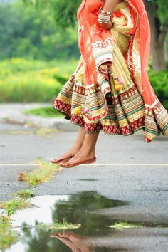 Splashing in puddles on your wedding day! Reminds you what the day is really about - you! #indianwedding
