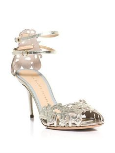 Charlotte Olympia juxtapose the delicate elegance of cut out floral leather with a metallic platinum finish.