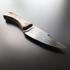 """Auction - Please bid on original post $200 starting bid!  Forged damascus blade. 5"""" cutting edge 9"""" overall.  The handle is highly chatoyant curly redwood with steel pins.  More pictures as the auction continues and don't forget to keep an eye out for the chef knife from the same billet   Auction rules: Auction will end at Midnight EST Sunday $5 bid increments shipping is included within the US $15 will be added for international. 5 minute anti sniping extension applies. I reserve the right…"""