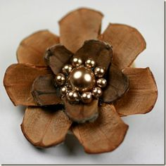 This has 2 different colors of pine cones.  Could use some that are bleached and unbleached too.