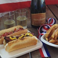 Homemade french fries and bacon-wrapped hot dogs are perfect with sparkling wine.