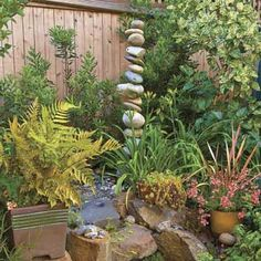 Stacked-stone fountain surrounded by low-maintenance plants creates a relaxing retreat.  | Photo: Mike Jensen | thisoldhouse.com