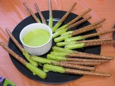 Don't think my son's teacher would appreciate me sending this one in for a Halloween party, but he'd sure love it.  Snot on a stick made with pretzel sticks and cheese dip dyed with green food coloring.