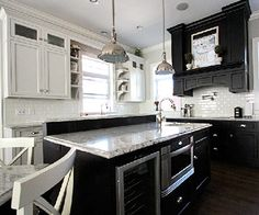 1920s-Inspired Kitchen. Black cabinetry with granite and a white subway tile backsplash
