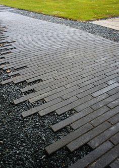 Scattered edge Boulevard pavers by Whitacre Greer #Landscape_Design ##Landscape_Design_Ideas #Simple_Garden_Design #optimumgarden.com                                                                                                                                                                                 More