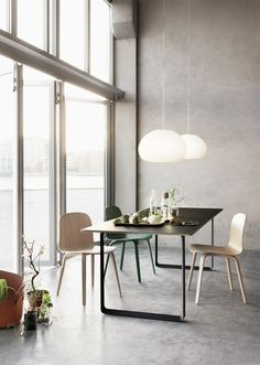 The Fluid pendant lamp is inspired by a resting drop of water. The lamp's soft round shape is enhanced by its frosted matte glass surface and perfectly matches its warm cosy light. The lamp can be hung as a single feature alone over a table or mixed in clusters with other small and large Flu