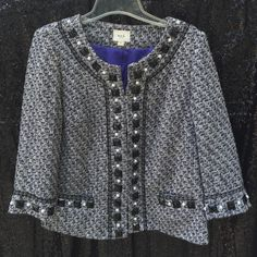 Tweed Luncheon Jacket Luxe tweed made up of black/gray/white/purple/silver accented with large black stones and pearls. The front is secured with hook and eye closures. Want to look like Chanel, but can only afford F21? Here's the answer to all of your problems! ECI Jackets & Coats