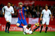 Lionel Messi Photos Photos - Lionel Messi of FC Barcelona (L) competes for the ball with Mariano Ferreira of Sevilla FC (R) during the match between Sevilla FC vs FC Barcelona as part of La Liga at Ramon Sanchez Pizjuan Stadium on November 6, 2016 in Seville, Spain. - Sevilla FC v FC Barcelona - La Liga