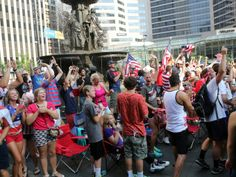 People celebrate a goal scored during a World Cup viewing party on Fountain Square on Monday.