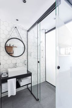 Hex tiles + matte black + no berm- roll in shower + long drain + continuous flooring.  Dark grout doesn't show dirt as easily and makes tile (like the hex tiles pictured above) really stand out.