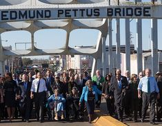 President Barack Obama, First Lady Michelle Obama and daughters Sasha and Malia wait with former President George W. Bush, former First Lady Laura Bush prior to the walking across the Edmund Pettus Bridge to commemorate the 50th Anniversary of the Selma to Montgomery civil rights marches, in Selma, Alabama, March 7, 2015.