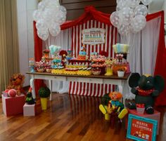 love how the cake is surrounded by all the other desserts. And then put the gifts on the floor surrounding the table!