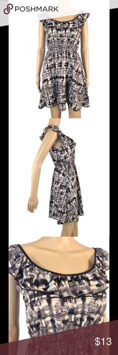 "NWOT printed dress NWOT - Never worn - No signs of wear.  Not see through in any sense.  Size medium - will fit sizes S-M.  Elastic waistband.  This would look adorable with a black belt or cardigan.  Ruffle detail at front bustline - goes all the way around the dress on the top.  Skirt flares out almost in a skater dress fashion.  Silky polyester like material No rips or stains.  Smoke free environment.  -  Mannequin measurements:  height - 5'8  Bust - 32""  waist - 24.5  hips - 32"" Dresses"