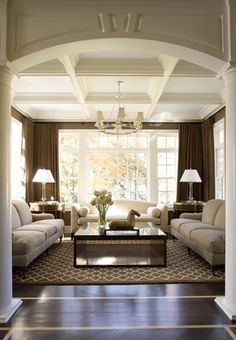 FORMAL BALANCE: OBJECTS ARRANGED IDENTICALLY ON EITHER SIDE OF CENTER POINT. If you were to divide the living room in half the furniture would be symmetrical including the couch, end tables, and lamps.