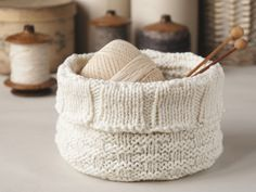 white baskets with 'woven' pattern are knitted in the round almost like hats. Firmness is not their strongest quality, when empty, so all th...