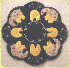 "This pattern makes an applique candle mat. It is made with felted wool but I think it could be made out of fabric as well. Finished Size 14"" Round."