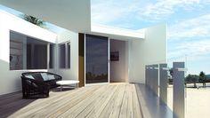 terrasse moderne qui donne sur la plage avec sol en bois, table basse galet et canapé design
