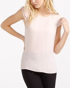 Flirty and feminine, this pleated sleeve blouse has the lightweight feel and look you want. Easy to wear, it features a flattering round neckline. Pair this top with a few accessories and black pants for a casual look. Canadian Clothing, Black Pants, Blouses For Women, Ready To Wear, Feminine, Casual, Sleeves, How To Wear, Shirts