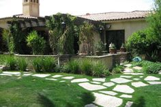 Backyard with large stone pathway and pretty covered patio, discovered on www.Porch.com