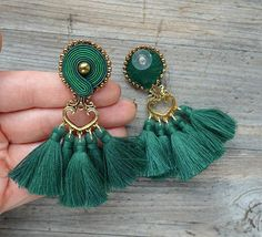 Earrings made in soutache embroidery technique. The color of green and gold. Material: hematite, toho beads, hand made tassels, decorative elements; Earrings length 8 cm (with earwire) 3.1 inch Finished with black felt. Impregnated. If you have a question, write to me :) Thread Jewellery, Tassel Jewelry, Beaded Jewelry, Handmade Jewelry, Soutache Earrings, Tassel Earrings, Etsy Earrings, Cheap Earrings, Walmart Jewelry