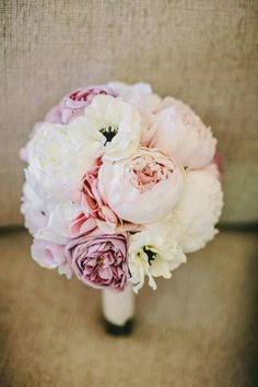 Lovely, Round Posy Comprised Of: Pastel Lavender Garden Roses, Pastel Pink Bud Stage Peonies, White Bud Stage Peonies, Pink Lisianthus, White Anemones..................................