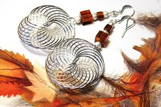 Eye of the Storm Earrings. Large Silver Wirewrapped Swirl. Sterling Beads. Amber Glass Cubes. Fall Colors. Handmade In Canada. tagt team $37.00