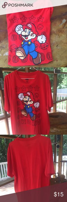 """Super Mario Red T-Shirt - Size XL This is a RED Super Mario T-Shirt Size EXTRA LARGE.  The t-shirt is 60% cotton and 40% Polyester.  This shirt is in """"Like New"""" condition with NO issues.  It measure 23"""" armpit to armpit.  It measures 29"""" down the center back.  SMOKE FREE HOME! Check my other listings!  I love to BUNDLE! SUPER MARIO Shirts Tees - Short Sleeve"""