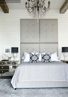 black, white, silver + awesome headboard + timber beams & stunning chandelier...