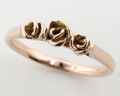 Three Dainty Roses Band, Rose Gold. $320.00, via Etsy.