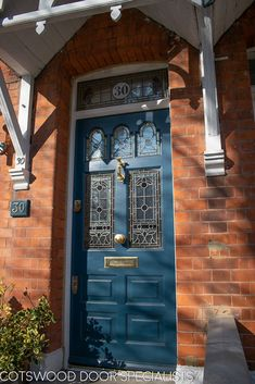 The dark blue colour on this Edwardian door looks best on a summers day. Its five lead glass lights have striking patterns that accompany ornate brass furniture - Cotswood Doors House Front Door, Glass Front Door, Sliding Glass Door, Cades, Traditional Front Doors, Victorian Front Doors, Garage Door Styles, Garage Doors, Edwardian House