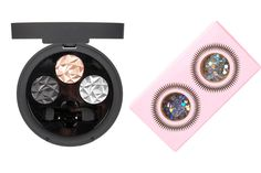 Secure your sex bomb status with a shimmery, smoky eye courtesy of the Prism Palette in icy shades of pink, blue, and black. If you really want to steal the spotlight, though, adorn yourself with designer Louise Gray's Glitter Pots. Who needs a disco ball?