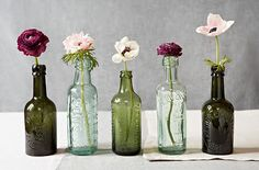 Old bottle collection and flowers for table centerpieces at wedding reception!!! Sweet!